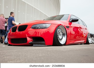 WROCLAW, POLAND: JUNE 28, 2014: Red BMW lowrider on a motor show in Wroclaw