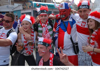 WROCLAW, POLAND - JUNE 8: Unidentified Polish, Czech Euro 2012 fans in Wroclaw fanzone on June 8, 2012 in Wroclaw. The EURO 2012 will be held from June 8 - July 1, 2012 hosted by Poland and Ukraine.