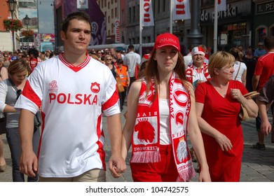 WROCLAW, POLAND - JUNE 8: Unidentified Polish couple visits Euro 2012 fanzone on June 8, 2012 in Wroclaw. The EURO 2012 will be held from June 8 - July 1, 2012 hosted by Poland and Ukraine.