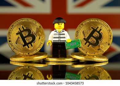 WROCLAW, POLAND - MARCH 10, 2018: Physical version of Bitcoin, Robber (as Lego figure) and United Kingdom Flag. Studio shot.