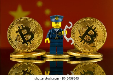 WROCLAW, POLAND - MARCH 10, 2018: Physical version of Bitcoin, Police Officer (as Lego figure) and China Flag. Studio shot.