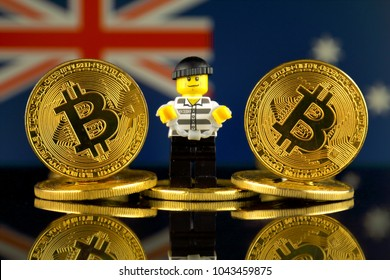 WROCLAW, POLAND - MARCH 10, 2018: Physical version of Bitcoin, Robber (as Lego figure) and Australia Flag. Studio shot.