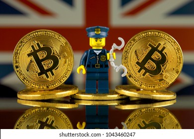 WROCLAW, POLAND - MARCH 10, 2018: Physical version of Bitcoin, Police Officer (as Lego figure) and United Kingdom Flag. Studio shot.