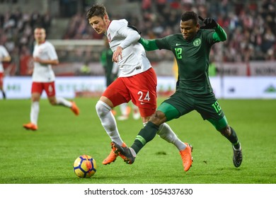 WROCLAW, POLAND - MARCH 23, 2018: Friendly match Poland vs Nigeria 0:1. In action Dawid Kownacki (L) and Abdullahi Shehu (R).