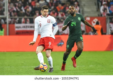 WROCLAW, POLAND - MARCH 23, 2018: Friendly match Poland vs Nigeria 0:1. In action Robert Lewandowski and Brian Idowu.