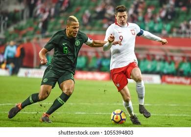 WROCLAW, POLAND - MARCH 23, 2018: Friendly match Poland vs Nigeria 0:1. In action Wiliam Ekong (L) and Robert Lewandowski (R).