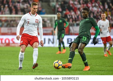 WROCLAW, POLAND - MARCH 23, 2018: Friendly match Poland vs Nigeria 0:1. In action Arkadiusz Milik (L) and Wilfred Ndidi (R).