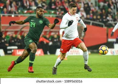 WROCLAW, POLAND - MARCH 23, 2018: Friendly match Poland vs Nigeria 0:1. In action  Brian Idowu (L) and Robert Lewandowski (R).