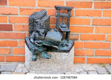 Wroclaw / POLAND - March 30, 2018: Wroclaw krasnale modern art small figurines in streets of Wroclaw streets, small dwarfs are great tourist attraction