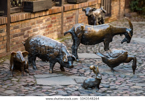 Wroclaw, Poland - March 9, 2018: Massacre of Wroclaw, bronze statue of the slaughter animals in the place of a medieval butcher