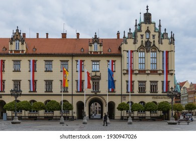 Wroclaw, Poland - May 03 2020: Market square and facade of building with Polish flags at 3rd of May