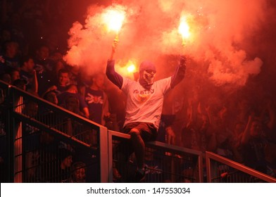 WROCLAW, POLAND - May 06: ultra supporters burn flares during match, Slask Wroclaw vs Lech Poznan on May 06, 2013 in Wroclaw, Poland.