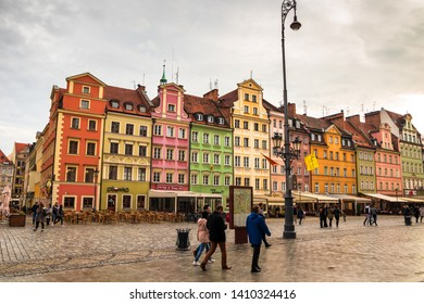 Wroclaw / Poland - may 09 2019: Wroclaw central market square (rynek) in Wroclaw old historic town with old colourful buildings and tourists at evening