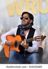 WROCLAW, POLAND - MAY 1, 2016: Al Di Meola during event Guitar Guinness World Record. Over 7 thousands guitarists achieve new Guiness Record playing Hey Joe by Jimi Hendrix.