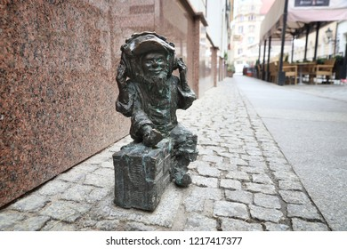 WROCLAW, POLAND - MAY 11, 2018: Gnome or dwarf listening to radio - small statue in Wroclaw, Poland. Wroclaw has 350 gnome sculptures around the city.
