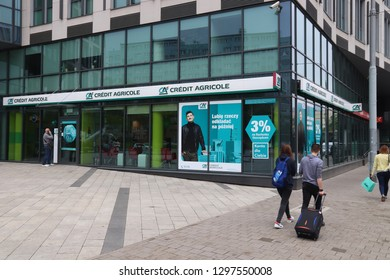WROCLAW, POLAND - MAY 11, 2018: People walk by Credit Agricole bank branch in Wroclaw, Poland. There are 36 banking companies present in Poland (2018).