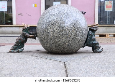 WROCLAW, POLAND - MAY 11, 2018: Sisyphus gnomes of dwarves small statues in Wroclaw, Poland. Wroclaw has 350 gnome sculptures around the city.