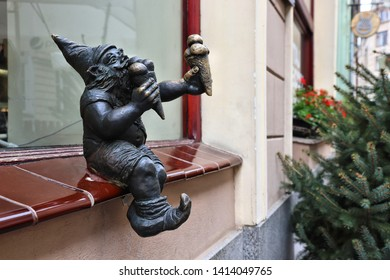 WROCLAW, POLAND - MAY 11, 2018: Ice cream gnome or dwarf small statue in Wroclaw, Poland. Wroclaw has 350 gnome sculptures around the city.