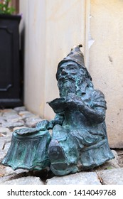 WROCLAW, POLAND - MAY 11, 2018: Gnome or dwarf small statue in Wroclaw, Poland. Wroclaw has 350 gnome sculptures around the city.