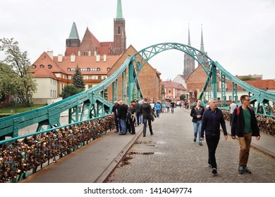 WROCLAW, POLAND - MAY 11, 2018: People visit Ostrow Tumski island in Wroclaw, Poland. Wroclaw is the 4th largest city in Poland with 632,067 people (2013).