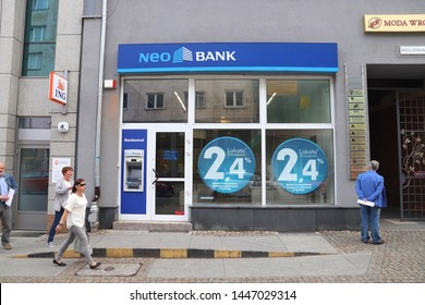 WROCLAW, POLAND - MAY 11, 2018: People walk by Neo Bank branch in Wroclaw, Poland. There are 36 banking companies present in Poland (2018).