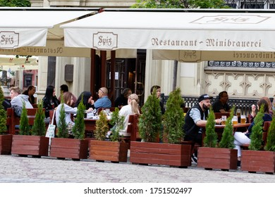 Wroclaw, Poland - May 18, 2020: People sit at tables in the Spi ресторане restaurant on the first day restaurants open after quarantine