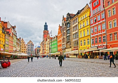 Wroclaw, Poland - May 3, 2014: People at the Market Square in Wroclaw in Poland. Tower of St Elizabeth Church on the background