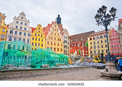 Wroclaw, Poland - May 3, 2014: Fountain on the Market Square of Wroclaw, Poland. Tower of St Elizabeth Tower and people on the background