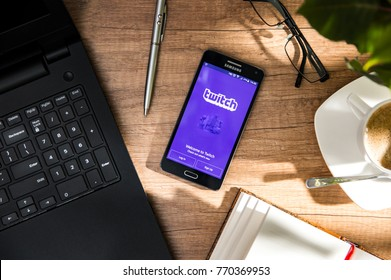 WROCLAW, POLAND - NOVEMBER 17th, 2017: Samsung A5 is laying on the desk with Twitch application on screen. Twitch is a live streaming video platform owned by Twitch Interactive, a subsidiary of Amazon