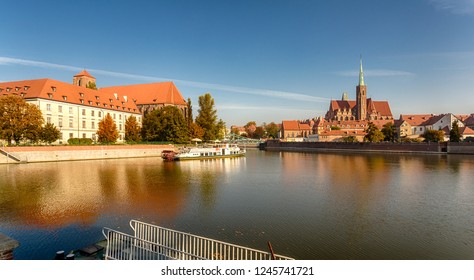 Wroclaw, Poland - October 10, 2018: Panorama of historic Wroclaw (view of the Tumsky Island, the Sand Island) from the Odra River Embankment.
