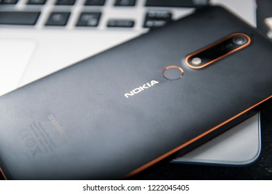 WROCLAW, POLAND -  OCTOBER 10th, 2018: Nokia 6.1 smartphone lies on laptop. Nokia 6.1 is a Nokia-branded upper-mid-range smartphone running the Android operating system.