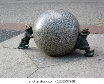 Wroclaw, Poland - October 13, 2011: Polish leprechauns who roll a granite ball