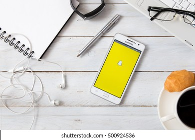 WROCLAW, POLAND - OCTOBER 15th, 2016: Samsung A5 with Snapchat application laying on desk. Snapchat is an image messaging and multimedia application created by E. Spiegel, B. Murphy, and R. Brown