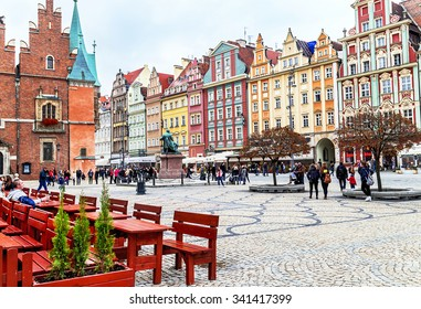 Wroclaw, Poland - October 17, 2015: People walking, resting on the famous, old market square in Wroclaw, Poland. Wroclaw is the historical capital of Silesia. Travel, vacation, arhitectura concept.