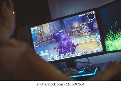 WROCLAW, POLAND -  SEPTEMBER 04th, 2018: Woman playing World of Warcraft: Battle of Azeroth game. WoW is a massively multiplayer online role-playing game (MMORPG) released in 2004 by.