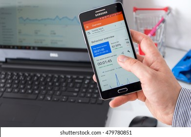 WROCLAW, POLAND - SEPTEMBER 07th, 2016: Businessman uses Google Analytics application on Samsung A5. Google Analytics is the one of most widely used application that tracks and reports website traffic