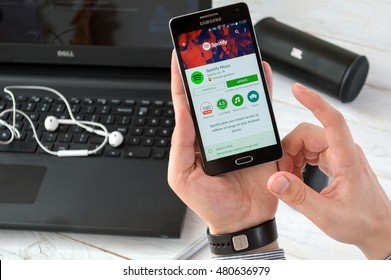 WROCLAW, POLAND- SEPTEMBER 09th, 2016:  Man install Spotify application on Samsung A5. Spotify is a Swedish music, podcast, and video streaming service. Music can be browsed by artist, album, genre.