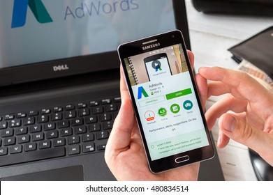 WROCLAW, POLAND- SEPTEMBER 09th, 2016:  Businessman installs Google Adwords application on Samsung A5. Adwords is advertising system that allows to display sponsored links in Google search results.