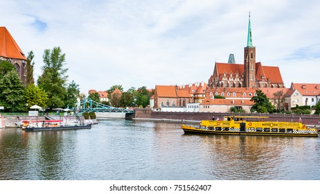 WROCLAW, POLAND - SEPTEMBER 12, 2017: excursion boat in Oder River near Ostrow Tumski island in Wroclaw city. Wroclaw is the largest city in western Poland, the historical capital of Silesia region