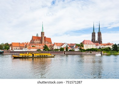 WROCLAW, POLAND - SEPTEMBER 12, 2017: excursion ship in Oder River near Ostrow Tumski island in Wroclaw city. Wroclaw is the largest city in western Poland, the historical capital of Silesia region