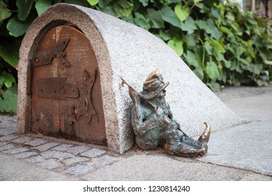 WROCLAW, POLAND - SEPTEMBER 2, 2018: Gnome or dwarf bronze statuette in Wroclaw, Poland. Wroclaw has 350 gnome sculptures around the city.