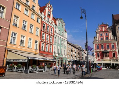 WROCLAW, POLAND - SEPTEMBER 2, 2018: People visit the city square (Rynek) in Wroclaw, Poland. Wroclaw is the 4th largest city in Poland with 632,067 people (2013).