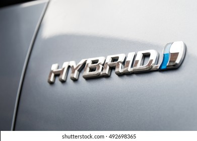 WROCLAW, POLAND - SEPTEMBER 29th, 2016: Hybrid logo on the Toyota car. Hybrid Synergy Drive (HSD) is the brand name of Toyota for hybrid car drive train technology.