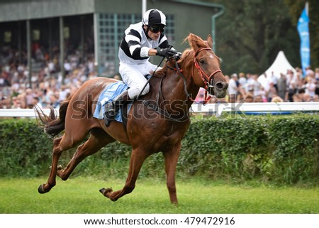 WROCLAW, POLAND - SEPTEMBER 4; 2016: Race for the 3-year horses  at Racecourse WTWK Partynice. In action   J. Mach on the horse Hary Lou.