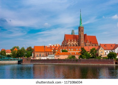 Wroclaw Poland view at Tumski island and Cathedral of St John the Baptist with bridge through river Odra. Picturesque landscape summer day blue sky white cloud