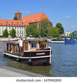 Wroclaw, Republic of Poland - May 19, 2019: A tourist river boat on the Oder River near embankment.