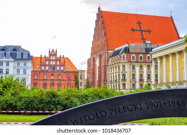Wroclaw/Poland- August 18, 2017: View of beautiful ornate historical houses, church of St. Dorothea, Hotel Monopol and Opera Theatre Buildings with part view of Witold Pilecki Memorial.