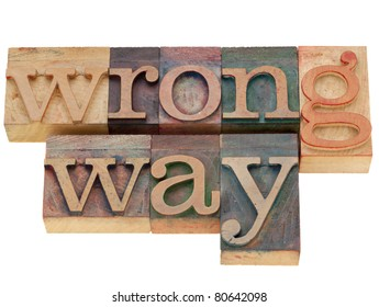 wrong way concept - isolated words in vintage wood letterpress printing blocks