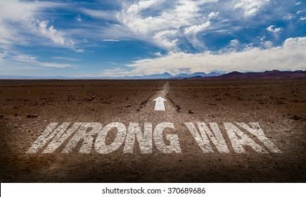 Wrong Way written on desert road