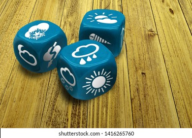 Wrong weather forecast concept poster. Inexact methods of prediction. Three dices with weather condition symbols on faces. Macro of blue gambling cubes on wooden table background